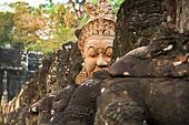 South gate to angkor thom in Cambodia is lined with warriors and