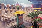 Photo of fragments of buddhist temple with prayer wheels and ornamental stone fences, stylized and filtered to look like an oil painting
