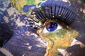 womans face with planet Earth texture and australian flag inside the eye