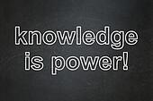 Education concept: Knowledge Is power on chalkboard background