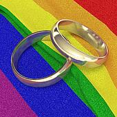 wedding rings on rainbow banner