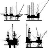 Silhouettes of drilling platform.