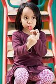 Little girl sitting on the slide
