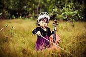 Kids play violin in a bushes