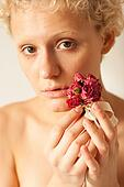 Sexy slim girl with dried rose in hands
