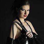woman in latex with whip