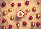 cappuccino with christmas tree shape and with red and gold chris