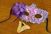 Hamantaschen cookie and Purim mask
