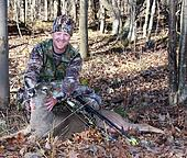 bow hunter with whitetail deer