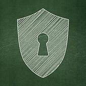 Security concept: Shield With Keyhole on chalkboard background