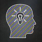 Marketing concept: Head With Light Bulb on chalkboard background