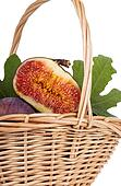 Bunch of figs in a basket isolated on white background