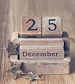 Old vintage wooden calendar set on the 25 of December with chris