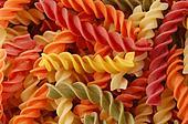 multi colored twirls pasta background