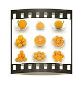 Set of half orange on a glass plate. The film strip