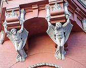 Architecture demons on wall of house in Kiev