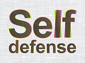 Protection concept: Self Defense on fabric texture background