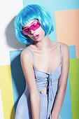 Eccentric Extravagant Woman in Styled Blue Wig and Pink Sunglasses
