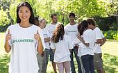 Confident volunteer gesturing thumbs up