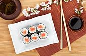 Japanese roll with salmon and fresh sakura branch