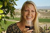 Woman Sips Wine