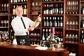Wine bar waiter happy male in restaurant