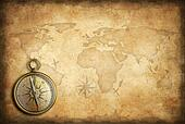 old brass or golden compass with world map background