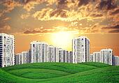 high-rise buildings over green hills