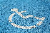 Blue handicap parking or wheelchair accessible sign in parking