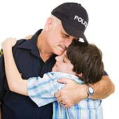 Police and Boy Hug