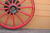 A old red wagon wheel