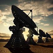 Radiotelescopes silhouette at sunset