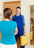 Housewife  meeting repairing engineer  at home