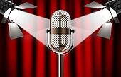 Microphone against red curtain with spotlights