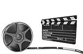 Metal film reel and clapperboard on a black background
