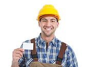 Confident Young Manual Worker Giving Visiting Card