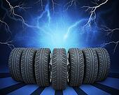 Wedge of new car wheels. Abstract background with lightning