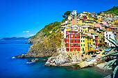 Riomaggiore village on cliff rocks and sea at sunset., Seascape in Five lands, Cinque Terre National Park, Liguria Italy Europe. Square format. Long Exposure