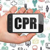 Medicine concept: Hand Holding Smartphone with CPR on display
