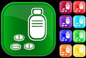 Icon of prescription bottle and pills
