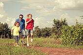 happy family walking on the road