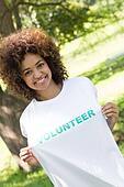 Environmentalist holding volunteer tshirt