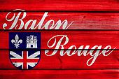 Flag of Baton Rouge, Louisiana, painted on old wood plank background