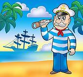 Sailor with spyglass on beach