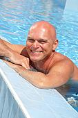 happy mature man in the swimming pool