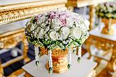 Romantic vintage rose bouquet on golden tray with pedestal