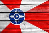 Flag of Wichita, Kansas, painted on old wood plank background