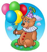 Bear clown with balloons on meadow