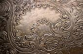 Tarnished silver scrollwork background
