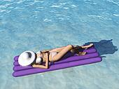 Woman relaxing in pool.